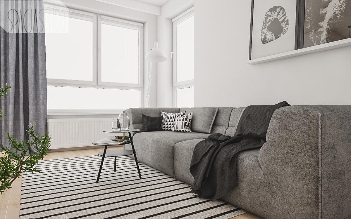Szara sofa w małym salonie    proj. Spacja Studio