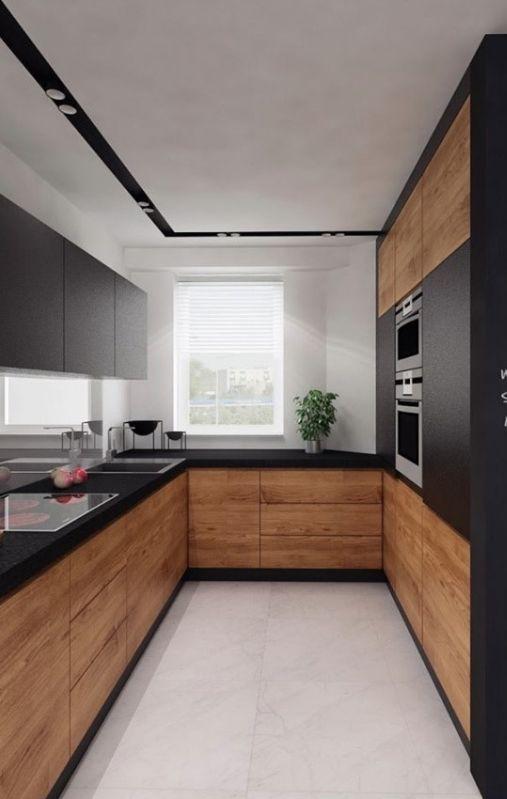 Czarno - drewniana kuchnia | proj. Pass Architekci