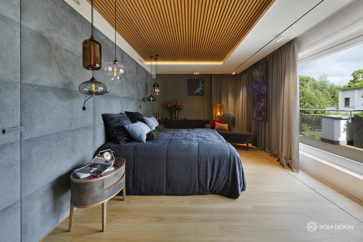 Tapicerowana ściana  w sypialni   proj. Hola Design