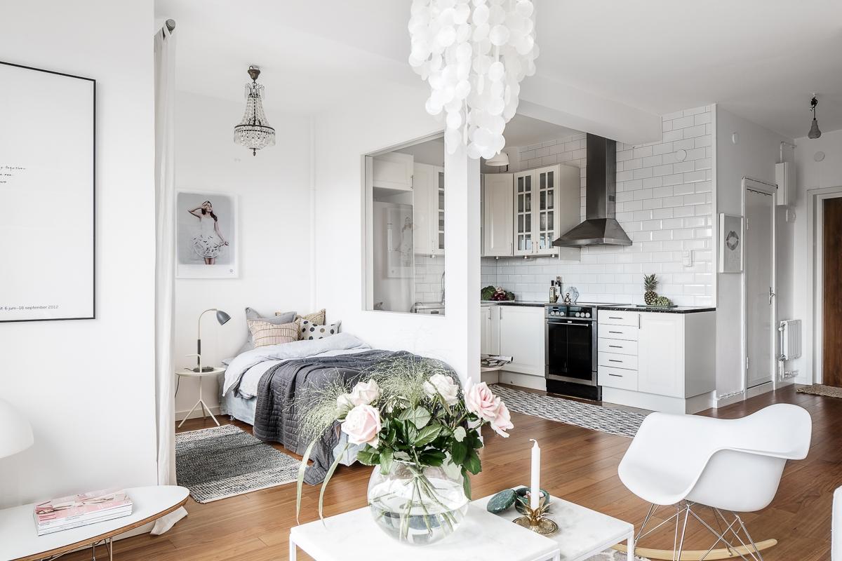 Pokój łączony salon i sypialnia w stylu skandynawskiego