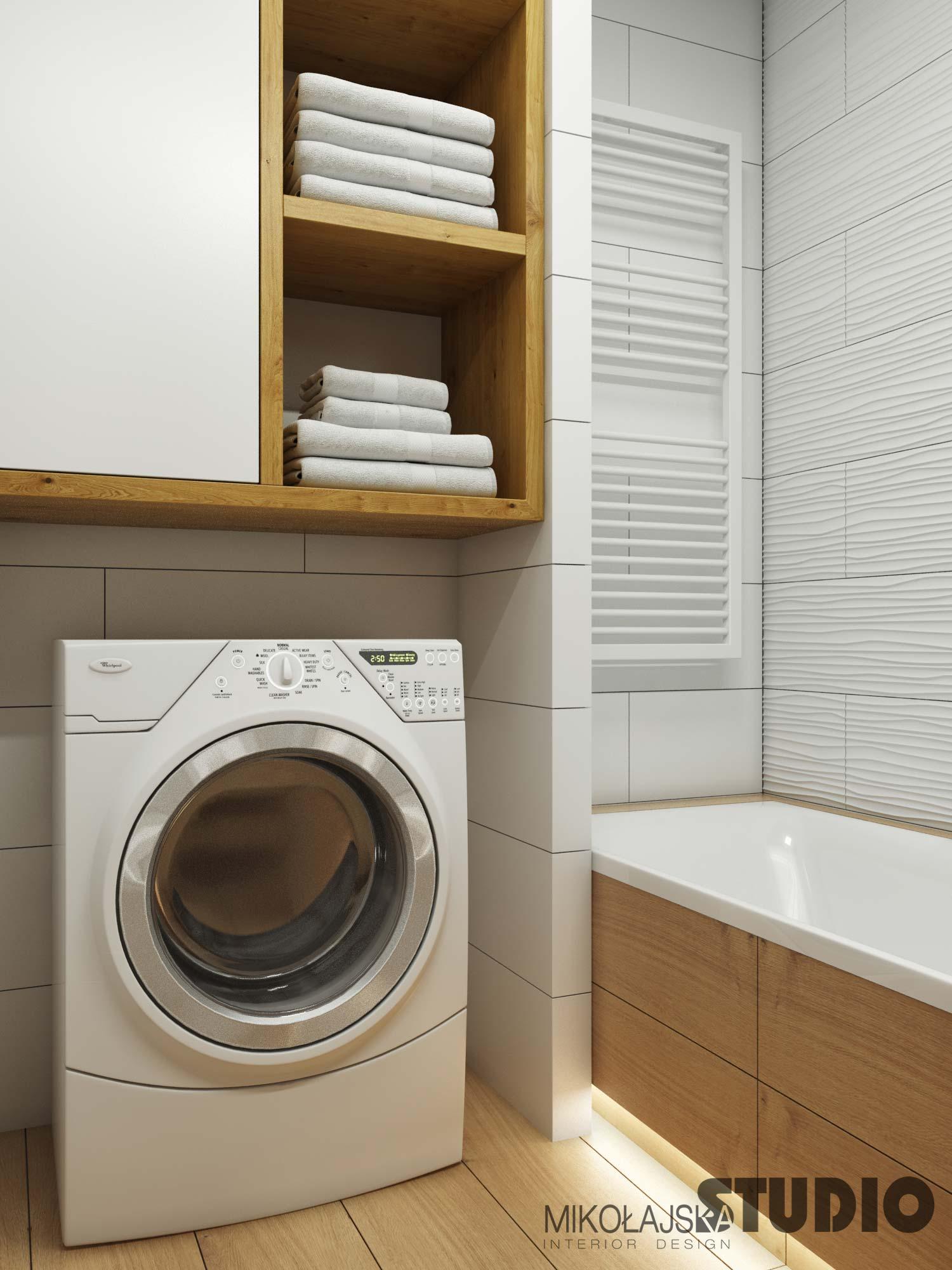 Projekt łazienki z płytkami drewnopodobnymi na podłodze | Projekt Mikołajska Studio