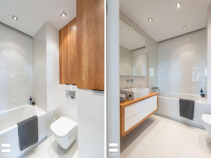 Wanna ze szklanym parawanem w małej łazience | proj. WZ Studio