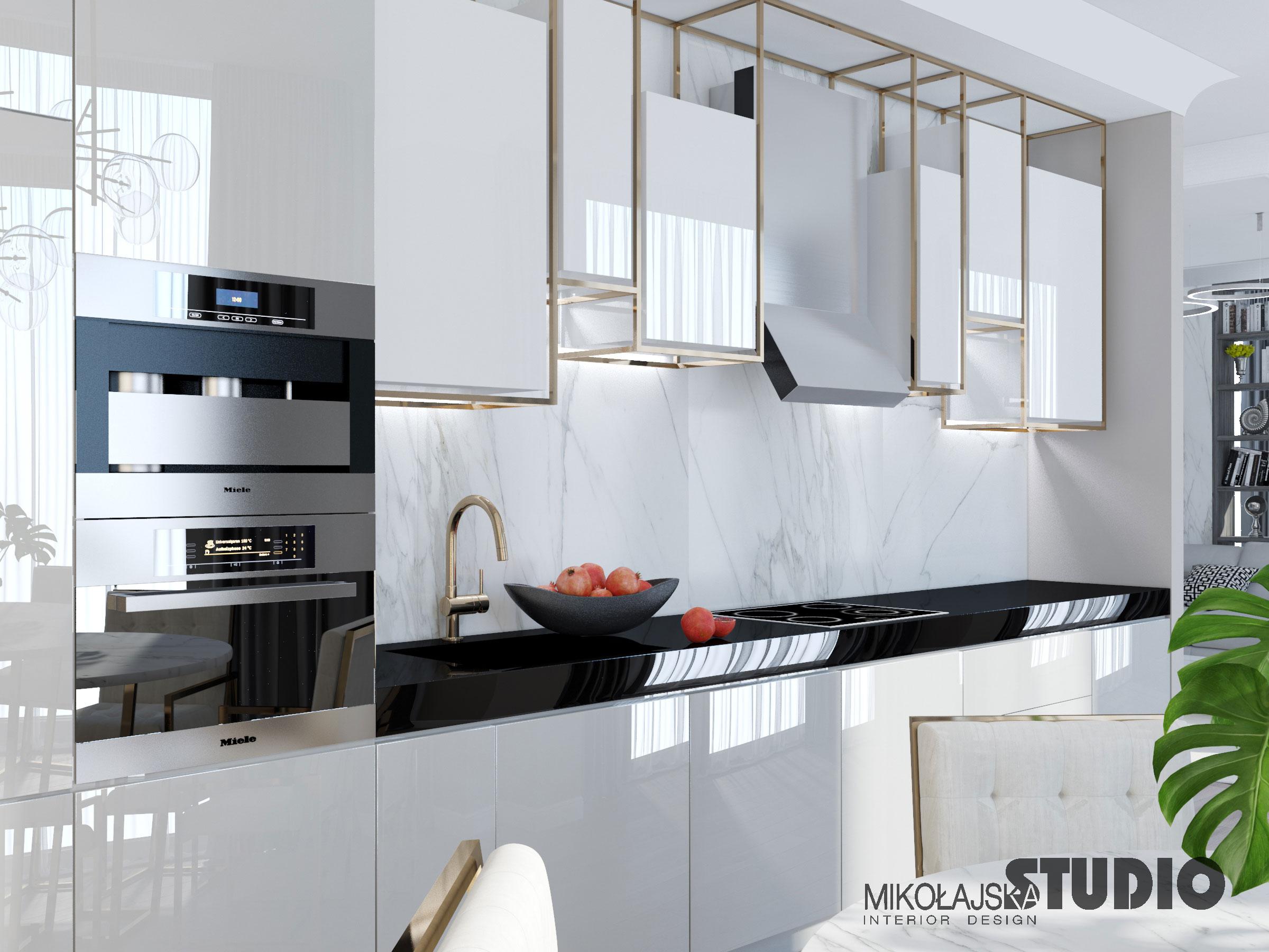 Złota armatura w kuchni | Projekt pracowni Mikołajska Studio