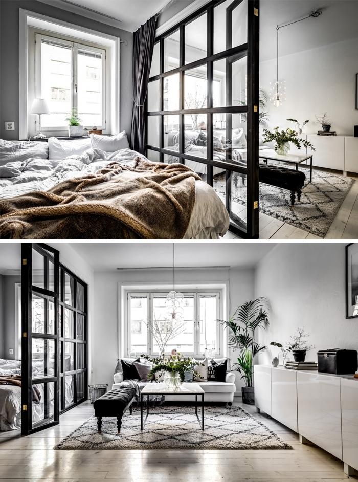 Sypialnia oddzielona od salonu industrialnym przeszkleniem i zasłoną