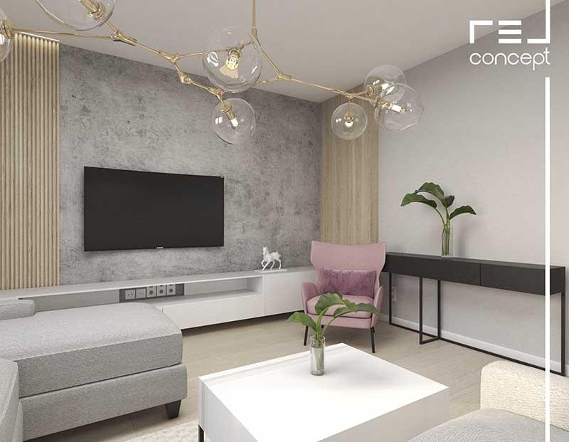 strefa telewizyjna w salonie z różowym fotelem