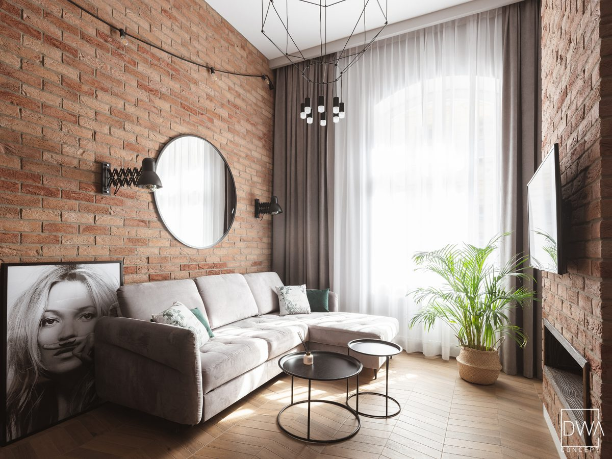 Mini loft z czarną kuchnią i sypialnią na antresoli | proj. DWAconcept