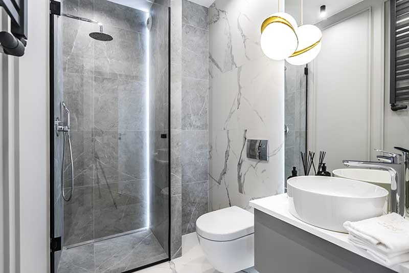 Szara łazienka projekt apartamentu w Warszawie Moovin Group