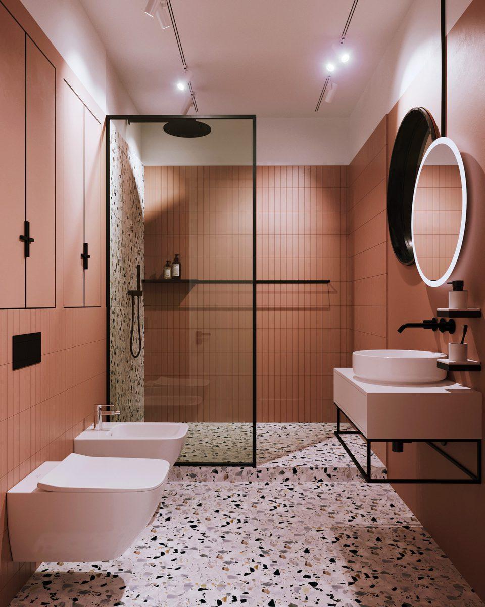 Czarne akcenty i lastryko dodają charakteru łazience, w której przeważa ciepły ton