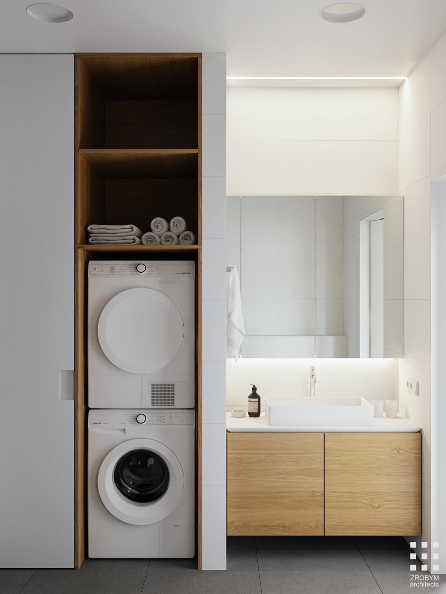 Minimalistyczna mała łazienka z pralką i suszarką