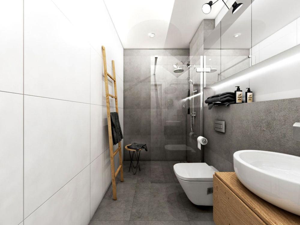 Płyty z betonu architektonicznego to ciekawy sposób na szarą łazienkę / proj. Pracownia Freedom
