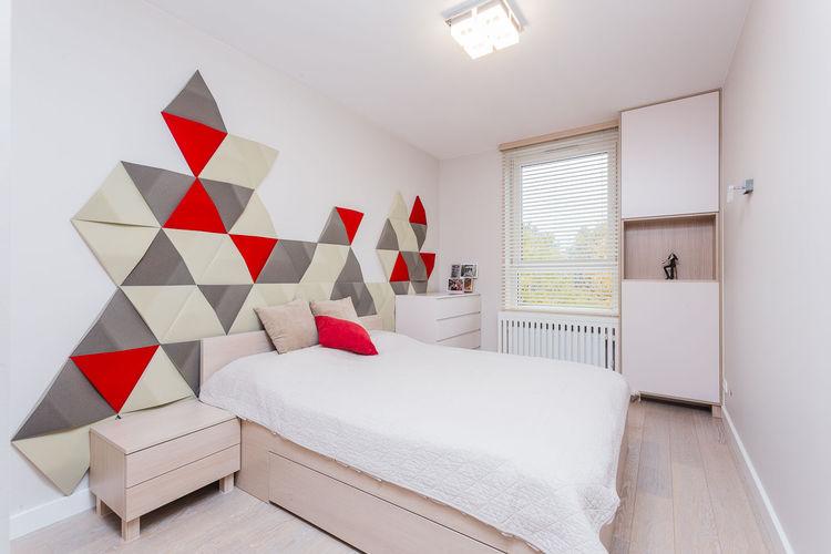 Ściana nad łóżkiem w geometryczny wzór | proj. Joanna Zawicka Projektowanie Wnętrz